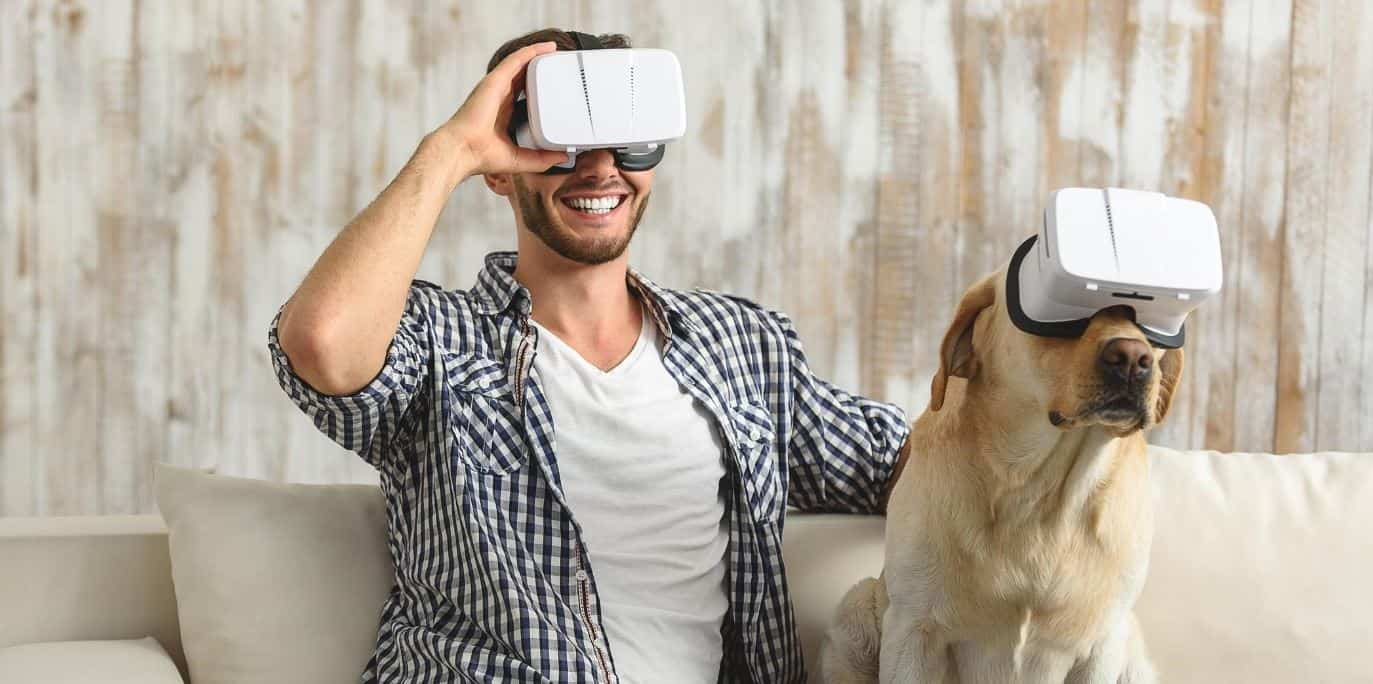 Man and dog wearing VR devices