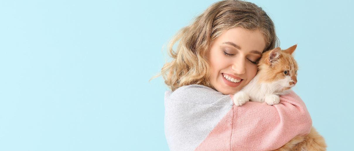 Lady hugs her kitty